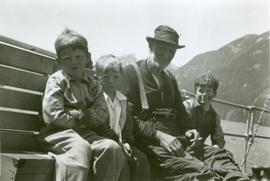 Man and Three Boys on Bench